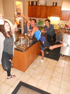 Yoga in the kitchen at a past retreat. What a bunch of posers we are ;-)